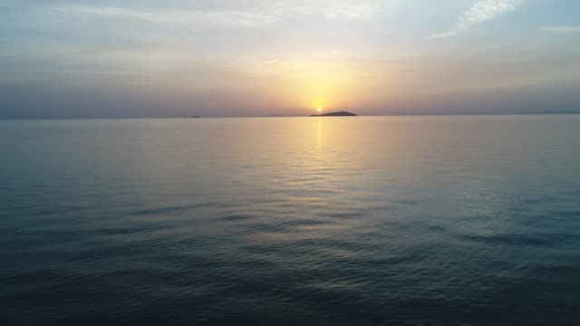 aerial advance view of calm ocean at sunset Aerial advance view of calm ocean at sunset, beautiful evening sky with reflected in calm sea water jp201806 stock videos & royalty-free footage