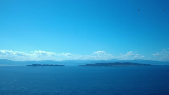 Aerial - Aegean Sea - Deep Blue - Spetses and Spetsopoula islands from a distance video