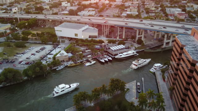 4K Aerial Approach of Boats at River Yacht Club at Sunset 2 video