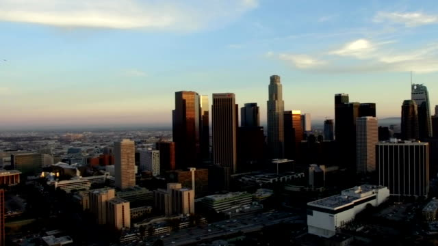 Aerial arc shot of Los Angeles skyscrapers at last light video