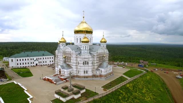 aerial around panorama of territory of monastery with big white church video