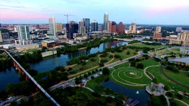 Aerial: Austin Downtown after sunset city lights turning on Aerial: Austin Downtown after sunset city lights turning on post modern architecture stock videos & royalty-free footage