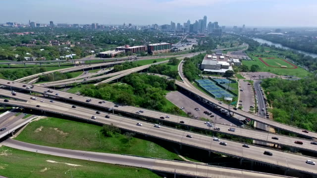 Aerial Austin Texas over Mopac Interchange at Downtown Cesar Chavez and 5th street Moving Away from Skyline Cityscape