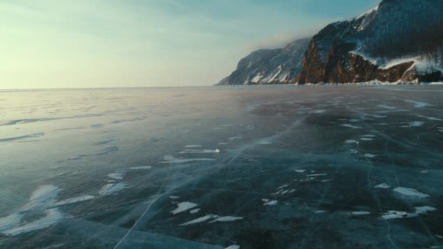 vídeos de stock e filmes b-roll de aerial baikal ice experience - lago baikal