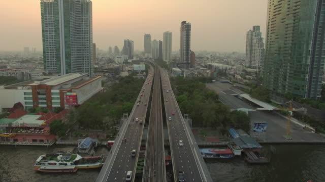 Aerial Bangkok Riverside Downtown at sunset video