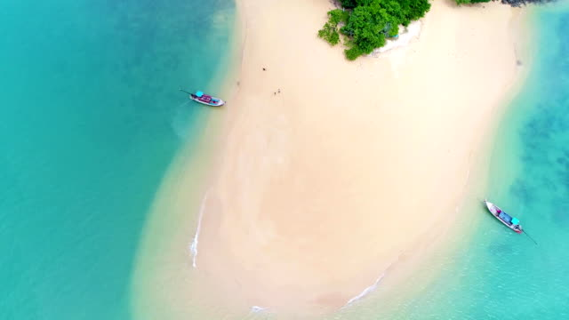 Aerial: Beautiful sandbank on small tropical island with palms in Thailand. Aerial: Beautiful sandbank on small tropical island with palms in Thailand. Andaman sea. military private stock videos & royalty-free footage