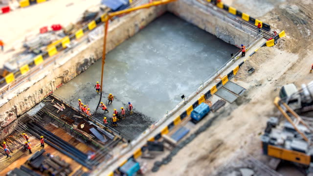 Aerial Big Construction Site Working 4K Time Lapse Tilt-Shift (zoom in)