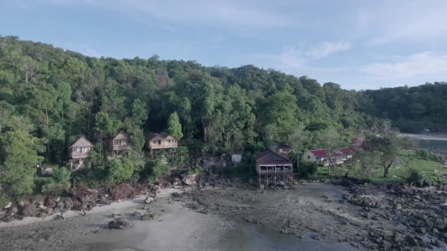 Aerial : bungalows and holiday houses on hill slope video