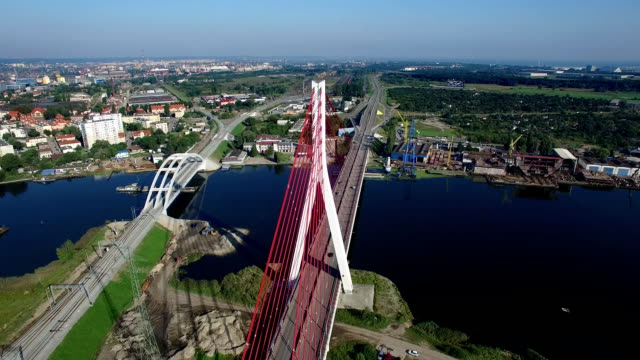 Aerial cable-stayed bridge on a river in Gdansk, Poland Aerial cable-stayed bridge on a river in Gdansk, Poland gdansk stock videos & royalty-free footage