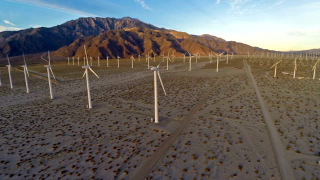 Aerial California Wind Mills Aerial shot of wind mills in the desert of California solar panels videos stock videos & royalty-free footage