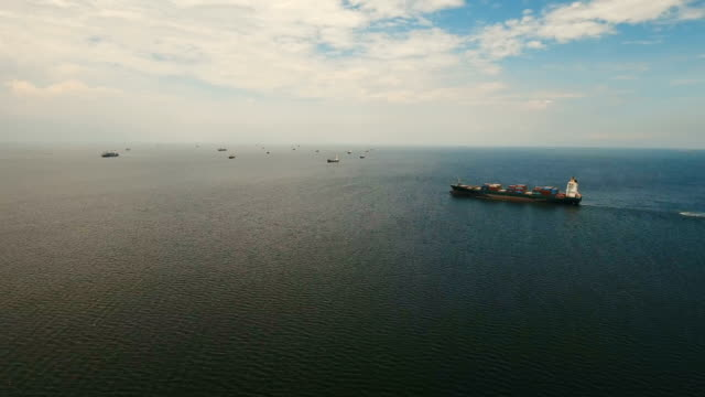 Aerial Cargo ships anchored in the sea. Philippines, Manila - video