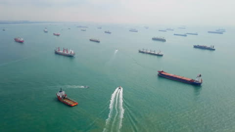 Aerial Cargo ships anchored in the sea. Singapore Aerial Cargo ships anchored in the sea. harbor stock videos & royalty-free footage