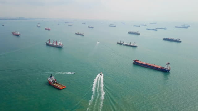 vídeos de stock e filmes b-roll de aerial cargo ships anchored in the sea. singapore - docas