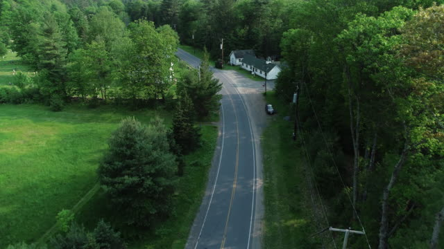 Aerial Catskills mountains church road cars forest summer New York