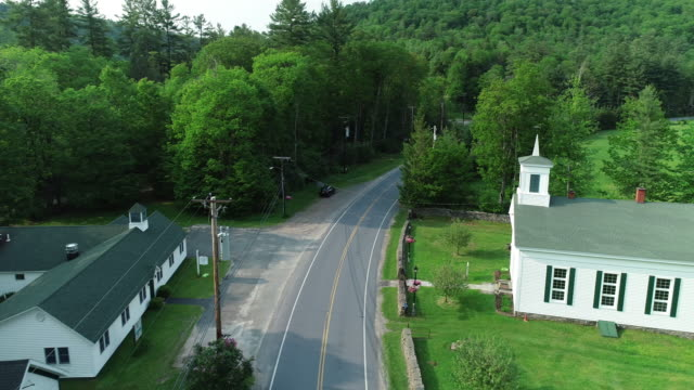 Aerial Catskills mountains road cars church forest summer New York