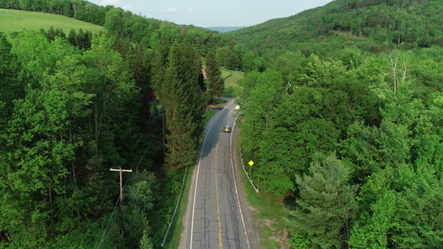 Aerial Catskills mountains road cars river forest summer New York