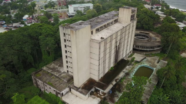 aerial circling third world abandoned former luxury hotel - liberia video stock e b–roll