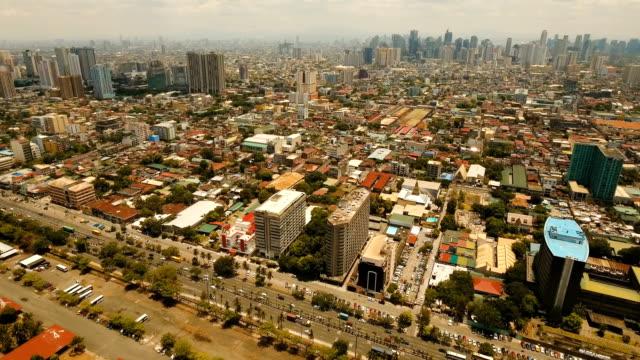 vídeos y material grabado en eventos de stock de antena ciudad con rascacielos y edificios. filipinas, manila, makati - filipinas