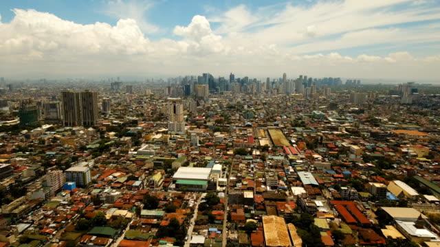 città aerea con grattacieli ed edifici. filippine, manila, makati - filippino video stock e b–roll