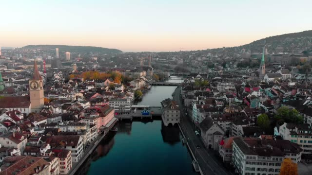 Aerial cityscape pulback reveal video of Zurich and River Limmat, Switzerland