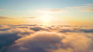 istock Aerial clouds to the sky in motion. Aerial view white clouds in blue sky during sunrise or sunset. Aerial top view cloudscape. Texture of clouds. Panoramic view. Clouds in motion. Fast playback 1199054763