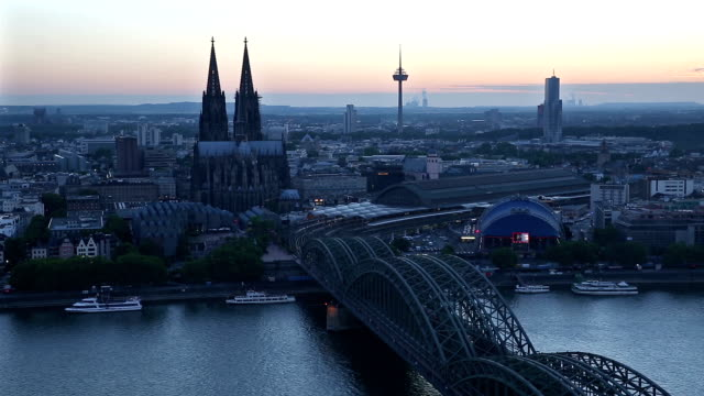 Aerial Cologne Cathedral Hohenzollern Bridge at dusk Germany video