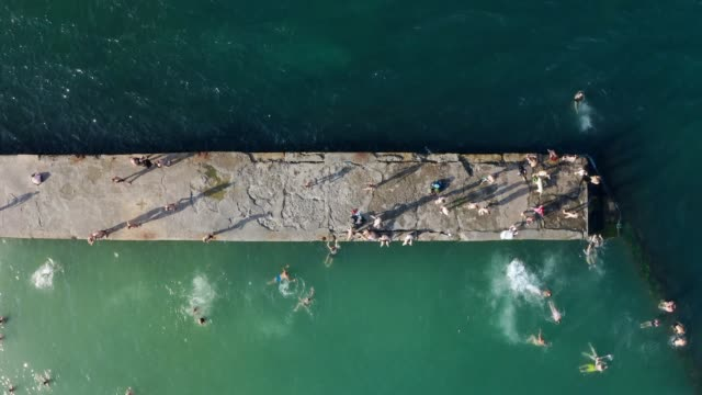 Aerial conceptual video from top. Summer active leisure weekend on the beach. - video