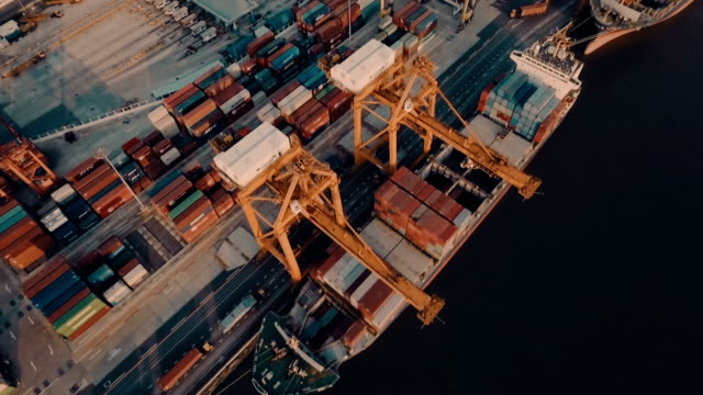 Aerial containers in container ship in harbor video