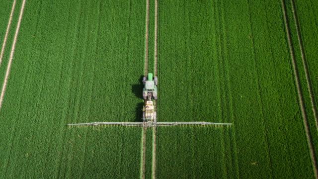 aerial: crop sprayer - aerial agriculture stock videos & royalty-free footage