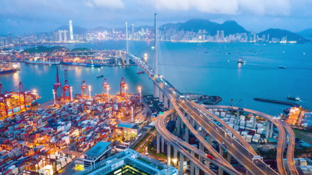Video Aerial Day to Night Time Lapse or Hyper Lapse of Kwai Tsing Container Terminals at Dusk