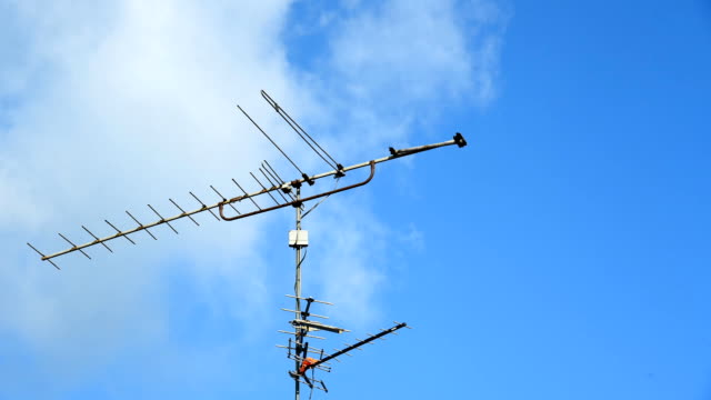 Aerial digital television radio antenna with cloud moving fast -timelapse video