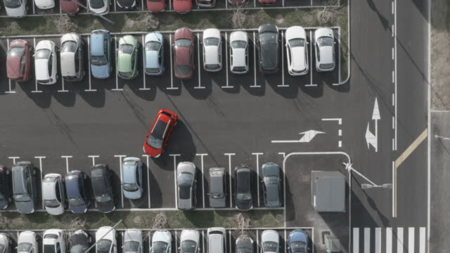4K Aerial: Dolly shot, Vehicle  Leaving Parking Lot video