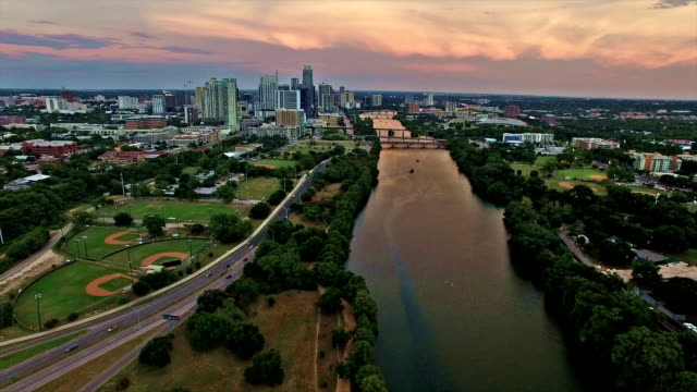 Aerial: Dramatic Golden Sky over Austin Texas with Colorado river reflections and a one of a kind view of Central Texas video