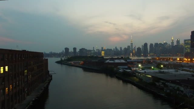Aerial Drift Through Creek Toward NYC Skyline video