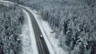 istock Aerial Driving on Winter 1053972346
