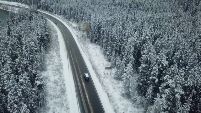 aerial driving on winter - aerial road stock videos & royalty-free footage