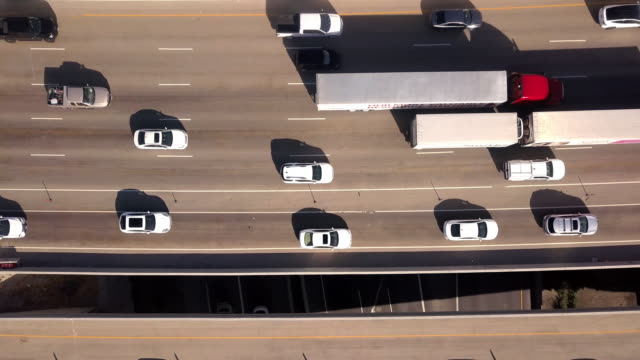 aerial drone clip looking down on i-15, i-80 of the commuter traffic and train in salt lake city - ingorgo stradale video stock e b–roll