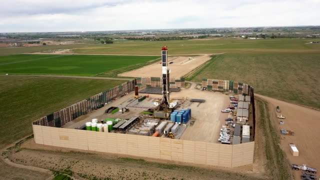 Aerial Drone Clip of a Fracking Drill Rig On The Eastern Slope Of Colorado In Late Springtime Aerial Drone Clip of a Fracking Drill Rig On The Eastern Slope Of Colorado In Late Springtime western usa stock videos & royalty-free footage
