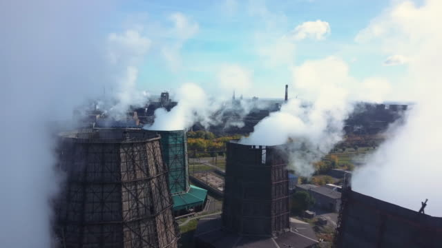 aerial; drone flight over the smoke stack; cooling system of plant - climate change video stock e b–roll