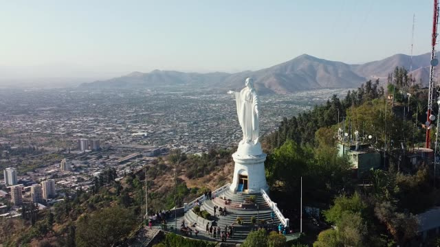 Aerial drone fly around Virgin Mary statue in Santiago