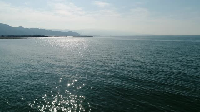 aerial drone flying, advance in of calm, blue sea video