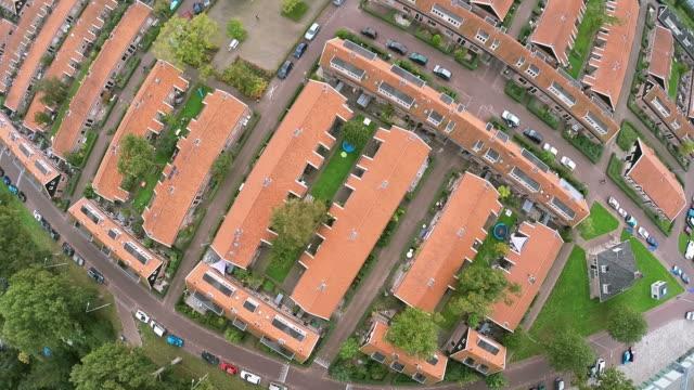 aerial drone flying over dense urban area in amsterdam - drone amsterdam bildbanksvideor och videomaterial från bakom kulisserna