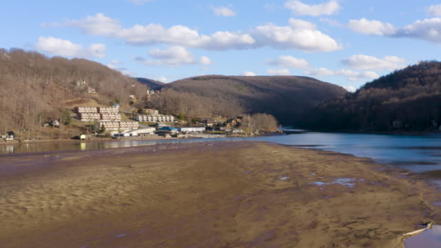 Aerial drone flying over low water level in Cheat Lake near Morgantown showing mud bank - video