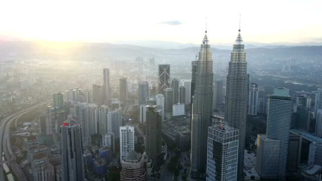 aerial drone footage at kuala lumpur city skyline - malese video stock e b–roll