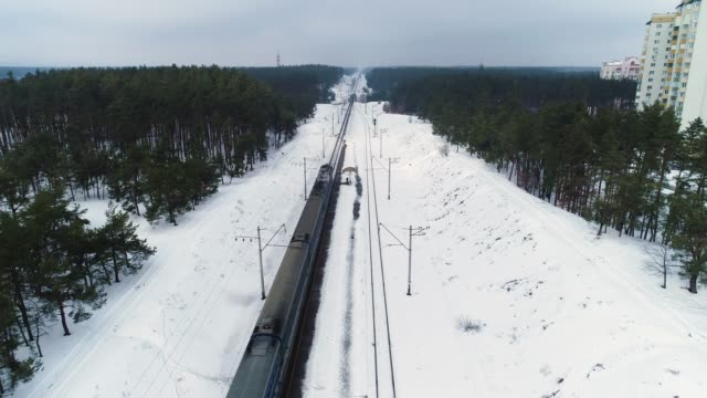 Aerial drone footage. Drone following train in winter forest Drone following train in winter forest siberia stock videos & royalty-free footage