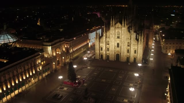 aerial drone footage of duomo in milan night - church architecture stock videos & royalty-free footage
