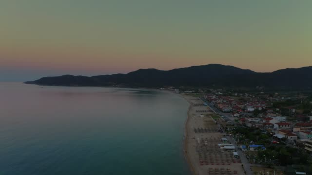 Aerial drone footage of the gulf, beach and town of Sarti, Sithonia, Halkidiki Peninsula at summer at late afternoon Aerial drone footage of the gulf, beach and town of Sarti, Sithonia, Halkidiki Peninsula at summer at late afternoon coastal feature stock videos & royalty-free footage