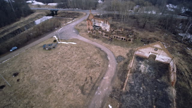 Aerial drone footage of the old ruined industrial building in Shemetovo town, Belarus, Eastern Europe The old ruined vinery in Shemetovo, Belarus, Eastern Europe. The aerial drone footage, 4K UHD video brick stock videos & royalty-free footage
