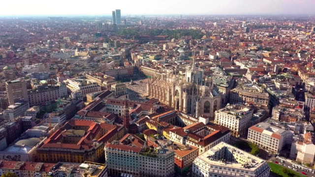 aerial drone footage view of cathedral dome in milan italy - lombardia video stock e b–roll