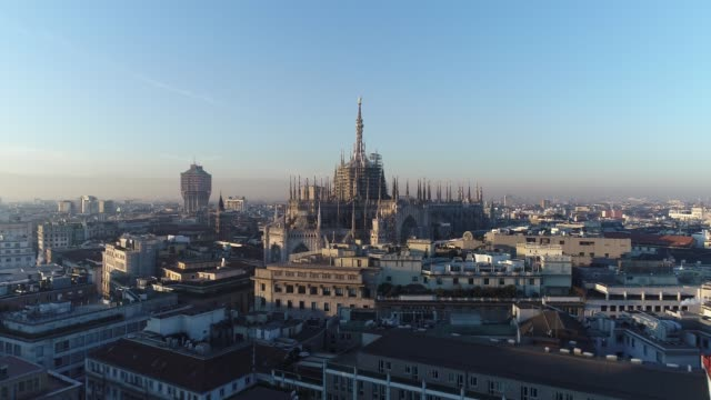 aerial drone footage view of cathedral duomo in milan - cathedrals stock videos & royalty-free footage